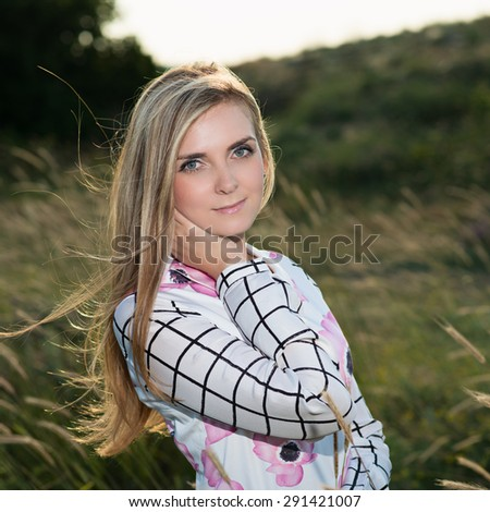 portrait of a beautiful young Caucasian girl outdoor. Beautiful modern woman with long hair in a dress. Photo with instagram style filters  - stock photo