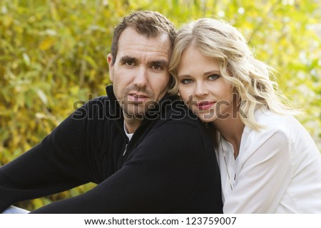 Portrait of a beautiful young couple outdoors - stock photo