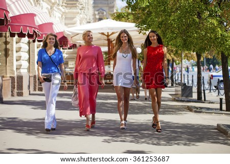 Portrait of a beautiful young four fashion women walk on summer city - stock photo