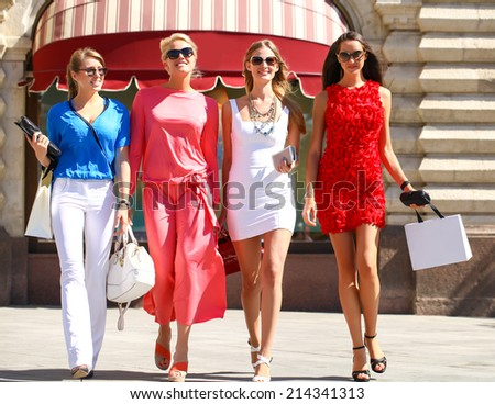 Portrait of a beautiful young four women walk on Red Square in Moscow - stock photo