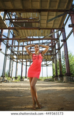 Portrait of a beautiful young girl at a construction site premises - stock photo