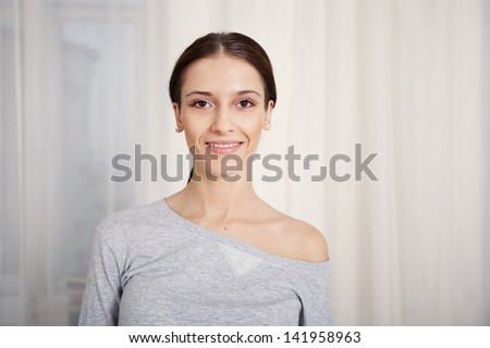 Portrait of a beautiful young girl closeup - stock photo