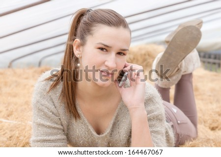 Portrait of a beautiful young girl using mobile phone - stock photo