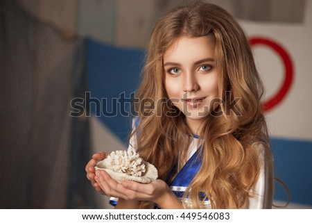 portrait of a beautiful young girl with her chic hair tresses blond curls with sound around blonde hair white dress flirts sailors beautiful eyes Teen Cutie hand look weird - stock photo