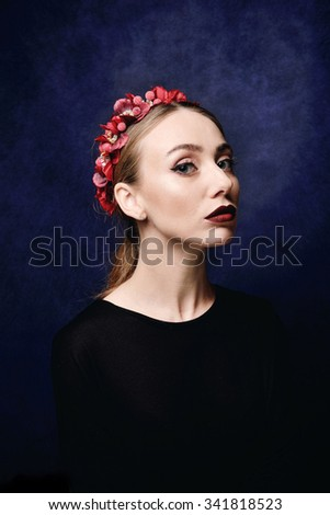Portrait of a beautiful young girl with make-up, clean skin and hair. Flowers in her hair. - stock photo