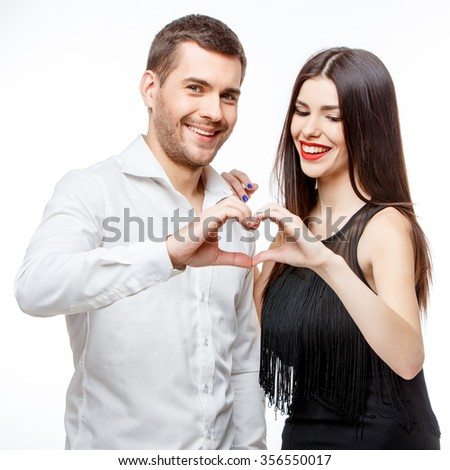 Portrait of a beautiful young happy smiling couple isolated on white - stock photo
