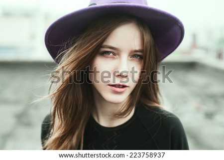 portrait of a beautiful young hipster girls on the roof on a sunny day - stock photo