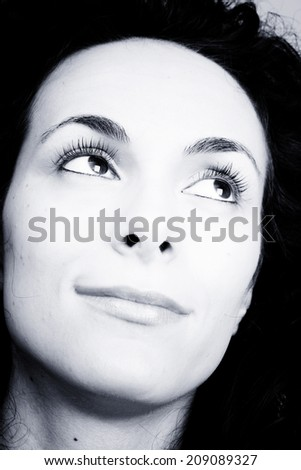 Portrait of a beautiful young lady smiling - stock photo