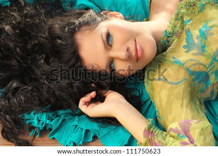 Portrait of a beautiful young lady smiling, brunette woman - stock photo