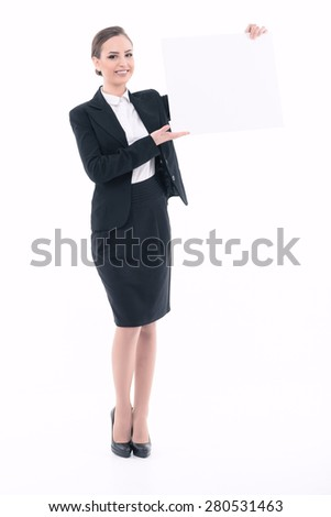 Portrait of a beautiful young lady wearing formal black jacket and white shirt holding a copyspace in her hands isolated on white background full length  - stock photo