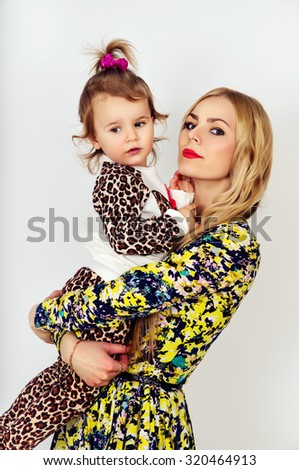 Portrait of a beautiful young mother with baby - stock photo