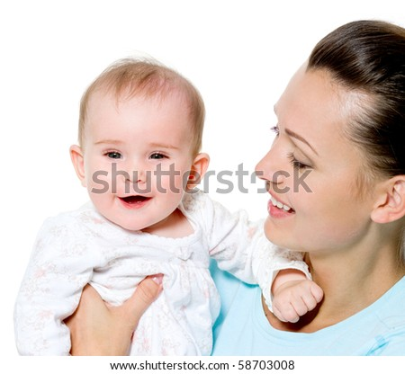 Portrait of a beautiful young mother with sweet newborn child - stock photo