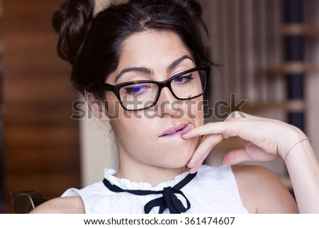 Portrait of a beautiful young serious woman thinking - stock photo