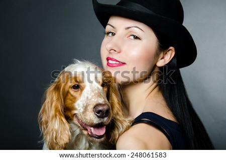 Portrait of a beautiful young woman and Russian Spaniel - stock photo