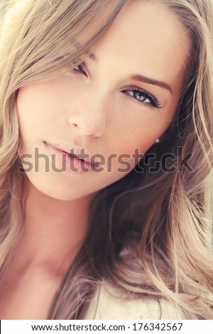 portrait of a beautiful young woman close up - stock photo