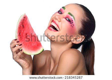 Portrait of a beautiful young woman eating watermelon. Isolated over white background. - stock photo
