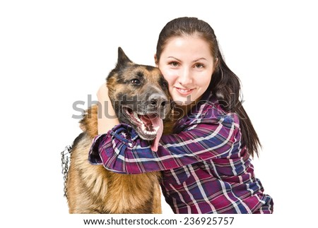 Portrait of a beautiful young woman embracing a German shepherd - stock photo