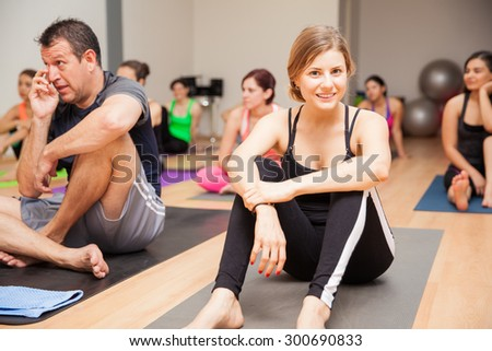 Portrait of a beautiful young woman enjoying her yoga class and smiling - stock photo