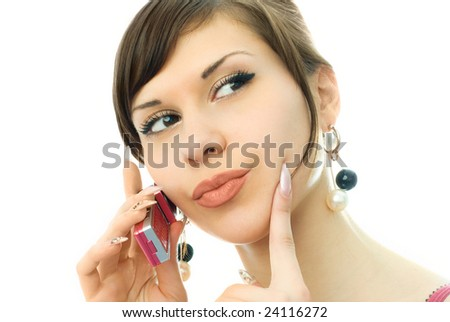 portrait of a beautiful young woman gossiping with her friend - stock photo