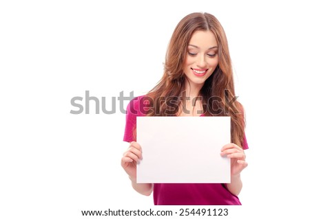 Portrait of a beautiful young woman holding a blank billboard, looking out from behind it. beautiful woman and blank sign - stock photo