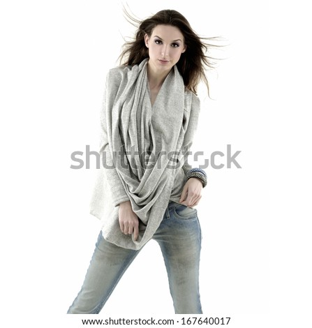 Portrait of a beautiful young woman in jeans with scarf posing  - stock photo