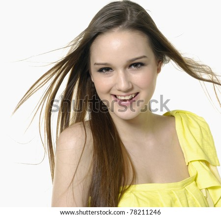 Portrait of a beautiful young woman looking happy - stock photo