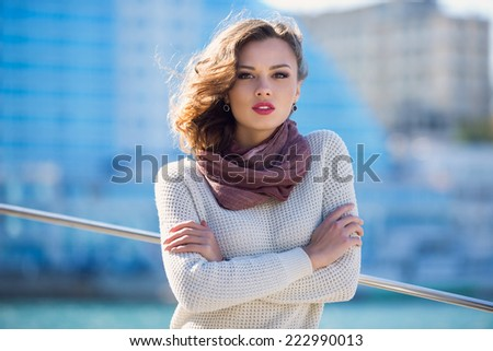 portrait of a beautiful young woman on the street - stock photo