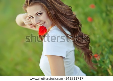 Portrait of a beautiful young woman outdoor in summer - stock photo