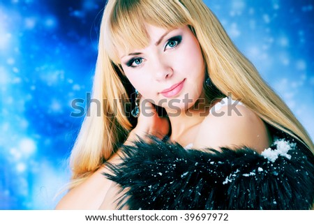 Portrait of a beautiful young woman over sky of stars and snow. - stock photo
