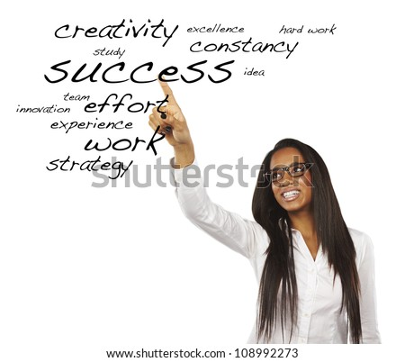 portrait of a beautiful young woman pointing at success words - stock photo