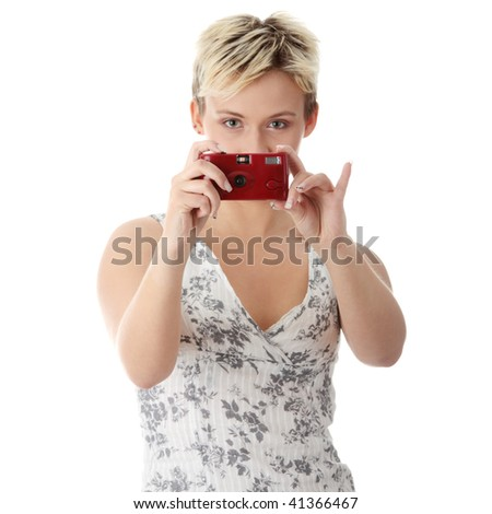 Portrait of a beautiful young woman talking a picture, isolated - stock photo