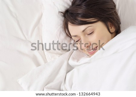portrait of a beautiful young woman waking up in the morning - stock photo