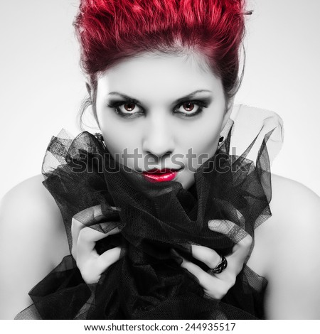 Portrait of a beautiful young woman with a demonic look. Fashion photo. - stock photo