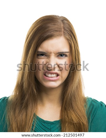 Portrait of a beautiful young woman with a disgusting face - stock photo