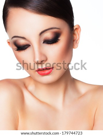 Portrait of a beautiful young woman with a glamorous retro makeup - stock photo
