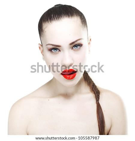 Portrait of a beautiful young woman with a professional make-up in the studio on a white background. Girl licks her lips - stock photo