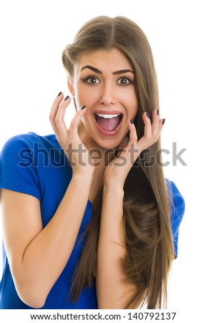 Portrait of a beautiful young woman with a shocked facial expression with mouth wide opened, isolated on white - stock photo