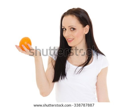 Portrait of a beautiful  young woman with an orange on a white background. - stock photo