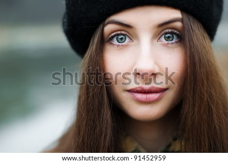 portrait of a beautiful young woman with big eyes - stock photo