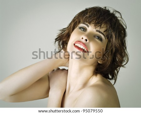 portrait of a beautiful young woman with brown short hairs - stock photo