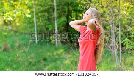 Portrait of a beautiful young woman with chic hair and eyes closed relaxing  - Outdoors - stock photo