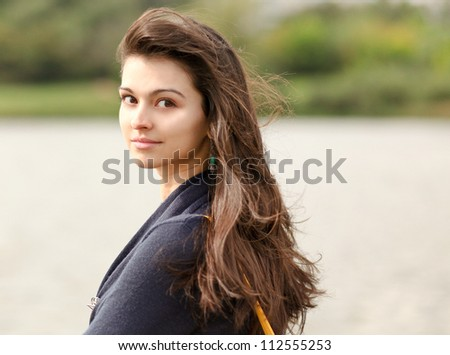 Portrait of a beautiful young woman with cute tangled hair - stock photo