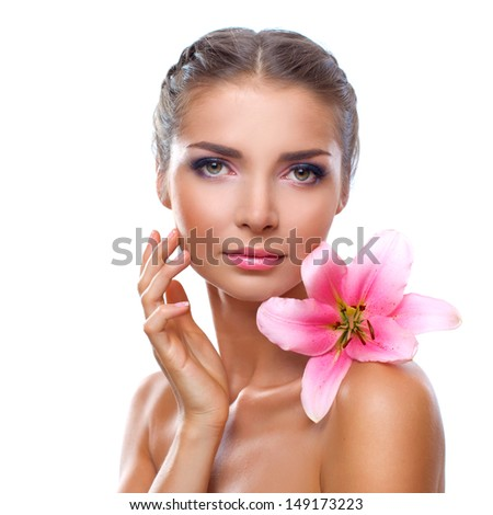 Portrait of a beautiful young woman with flower lily in her hand over white background - stock photo