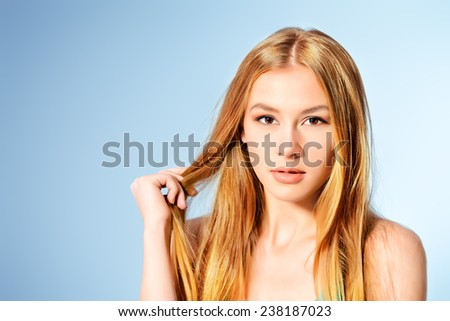 Portrait of a beautiful young woman with natural make-up and blonde hair. Beauty, Healthcare. - stock photo