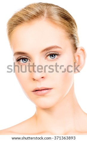 Portrait of a beautiful young woman with natural make-up. Spa girl. Skincare, healthcare. Studio shot. Isolated over white. - stock photo