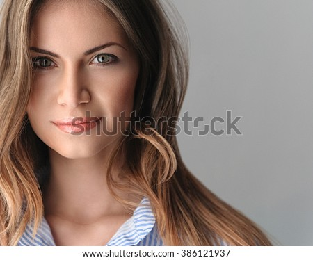 portrait of a beautiful young woman with perfect skin and beautiful hair closeup - stock photo