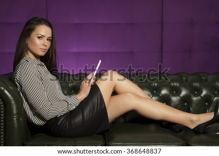 Portrait of a beauty young adult attractive sensuality and sexy pretty brunette businesswoman working on tablet on luxury retro vintage style sofa at home - stock photo