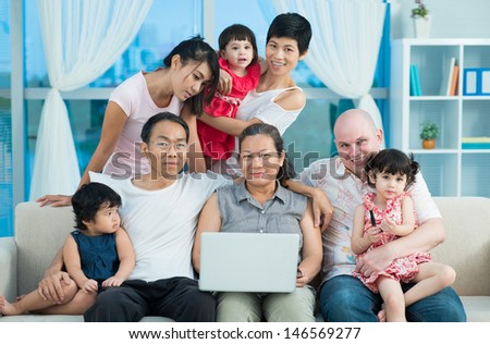 Portrait of a big international family at home - stock photo