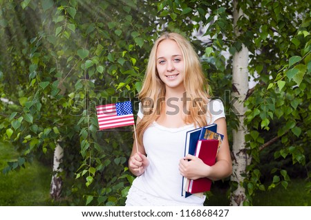 Portrait of a blond girl with USA flag - stock photo