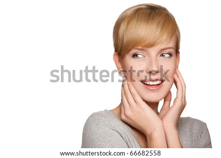 Portrait of a blond smiling woman looking at copyspace, isolated on white background - stock photo